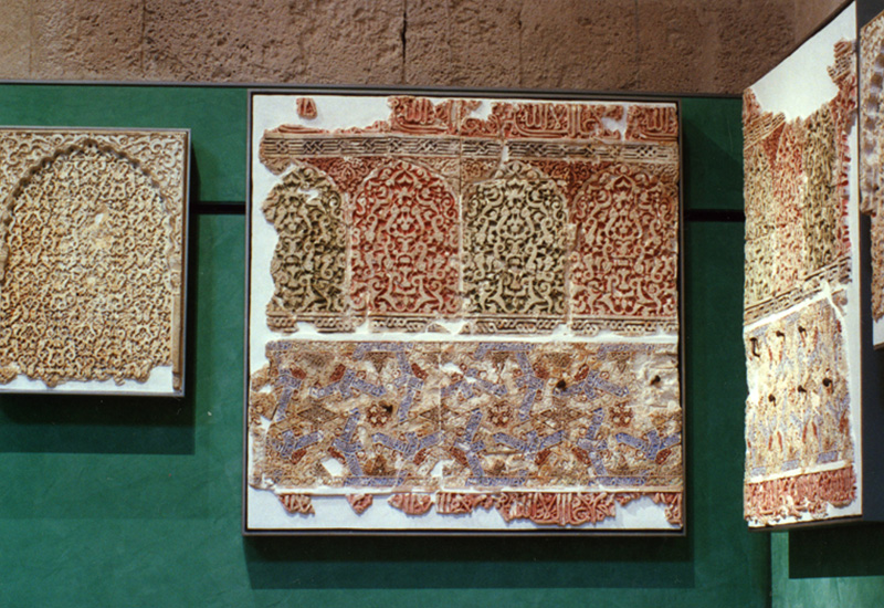 Plasterwork panels (Nasrid period, 1273-1309). Detailed decoration and original polychromy.